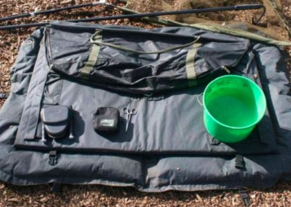 The carp fishing gear you need when you have a carp on the bank