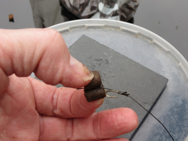 Place the other pellet ontop so that the hair less rig is sandwiched between the flat side of each pellet and hold for about 10 seconds