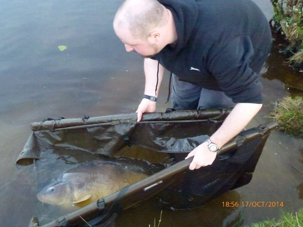This carp weighs in at 36lb 5oz, and is another stunning looking fish and as it's the last fish of the trip Vin even decides to go in the lake with it to release it. With that we decide it's time to call it a day and pack away the last of our gear.