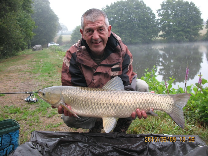 Paul,s first grass carp. He had not caught one before.