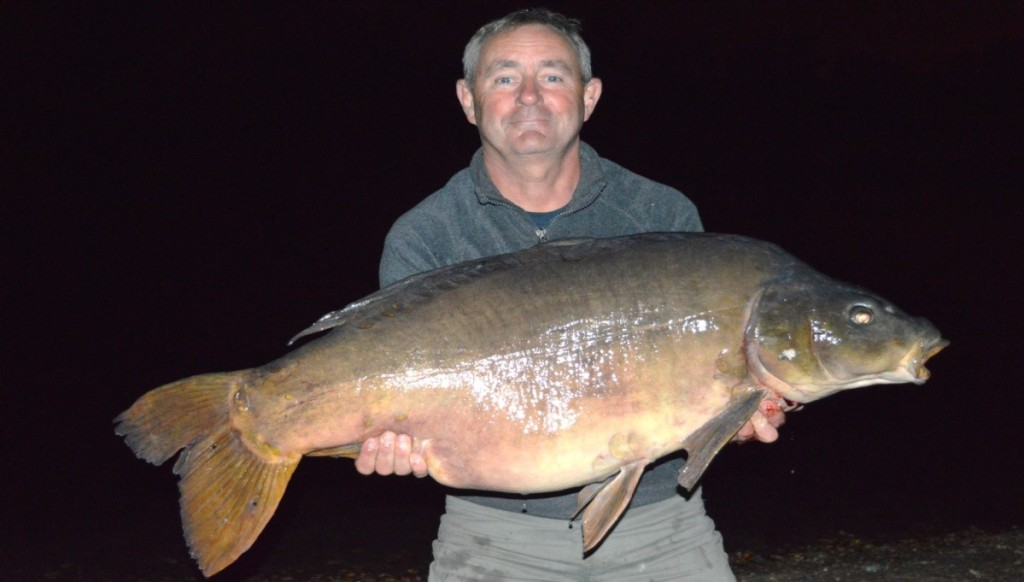My 52.8 Mirror. I was to see this fish again in November, note the bottom cluster of scales above fin.