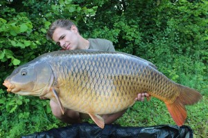 Bruno Simond with a common carp