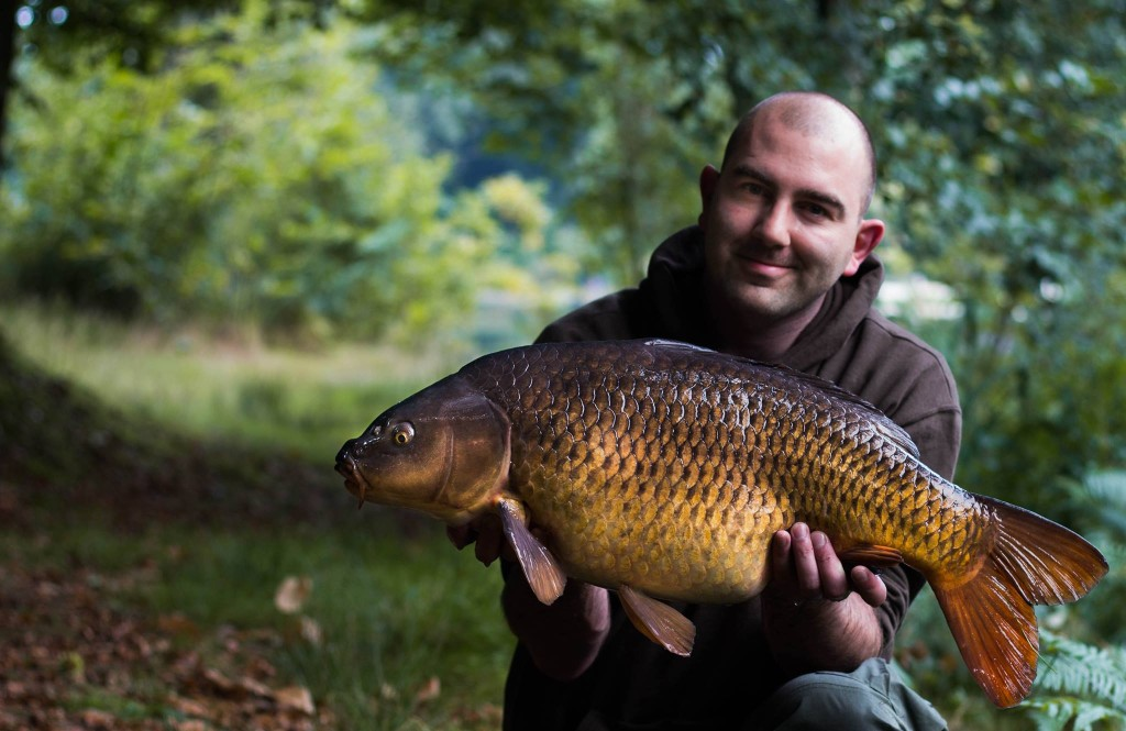 Mike Linstead with a stunning common carp from Vaux lake in France
