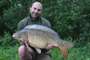 Angling Lines Field Tester Mike Linstead with a carp from Blue Lake, France