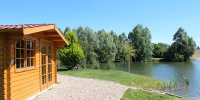 carp fishing France with wooden lodge