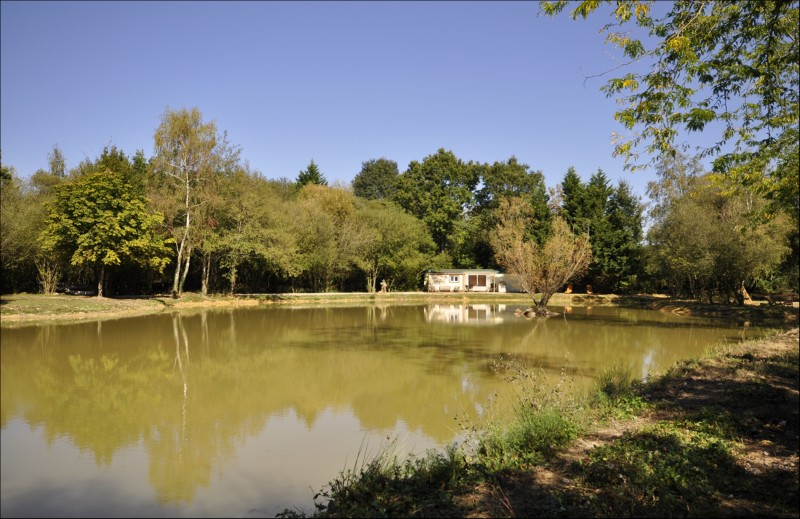 Eau De Vie French Carp Fishing Lake with lakeside lodge